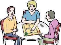 Drei Menschen mit Brettspiel