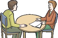 zwei Menschen am Tisch